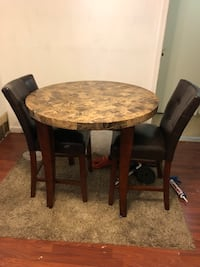 Round brown wooden table with two chairs District Heights, 20747