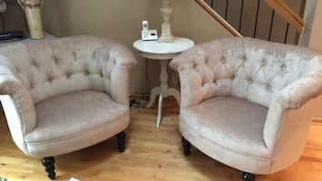 Two white fabric sofa chairs excellent condition pick up in Plymouth