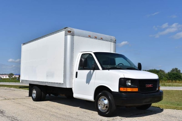 white and black Ford Transit dropside truck