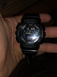 Round black casio g-shock digital watch 381 mi