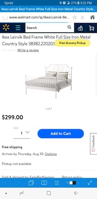 white metal Ikea bed frame
