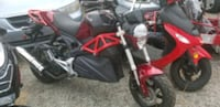 red and black sports bike like Kawasaki ESPAÑOL  Houston, 77055