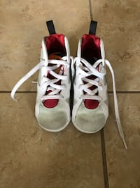 pair of white-and-red Air Jordan basketball shoes Orlando, 32824