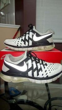 pair of white-and-black Nike running shoes with box Surrey