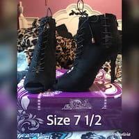Pair of black leather high heels  Guadalupe, 93434