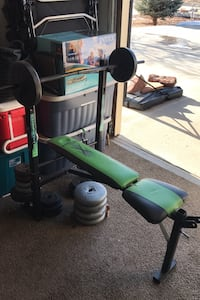 Weight bench with plenty of weights you must pick up