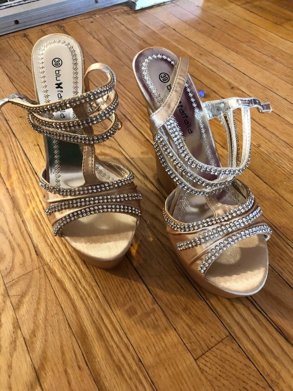 Pair of silver-colored open toe ankle strap heels