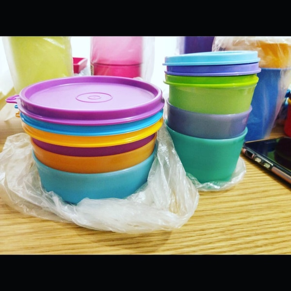 Assorted-color plastic container lot