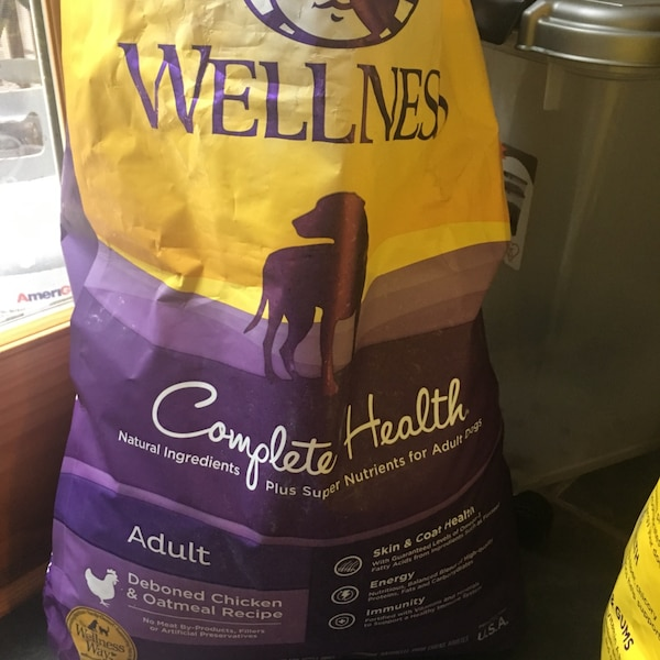 FREE two bags of welness dog food, half full and one 35-40% full
