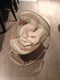 baby's green, white, and gray bouncer