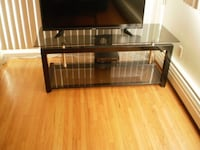 black flat screen TV with brown wooden TV stand VANCOUVER