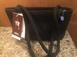 SAC purse black NEW with tags !!!