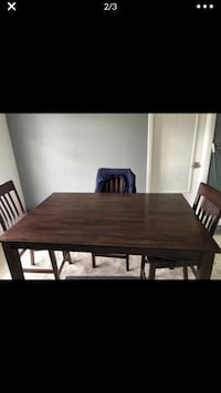 Expandable bar height dining table with 4 chairs Bradenton