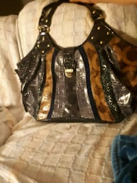 black and brown leather hobo bag Medicine Hat, T1A 7M1