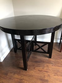 Round black wooden coffee table. Width 48. Height 36. Table only, no chairs.  Mississauga, L5M