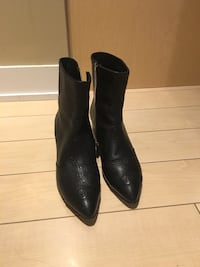 pair of black leather pointed toe booties Toronto, M8Y 0A1
