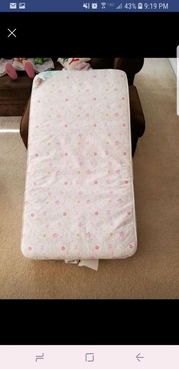 white and pink floral mattress