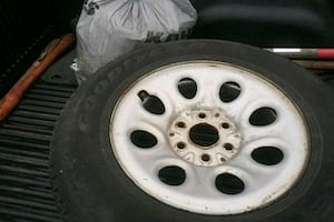245/70R17 good year with rim mounted 6 logs