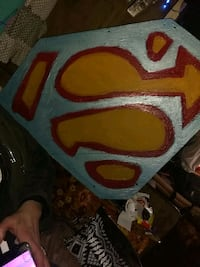 red and blue Superman logo 2065 mi