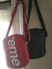 two black and red Supreme leather crossbody bags Kitchener, N2E 4J5