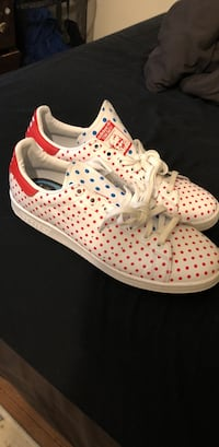 pair of white-and-red Adidas sneakers
