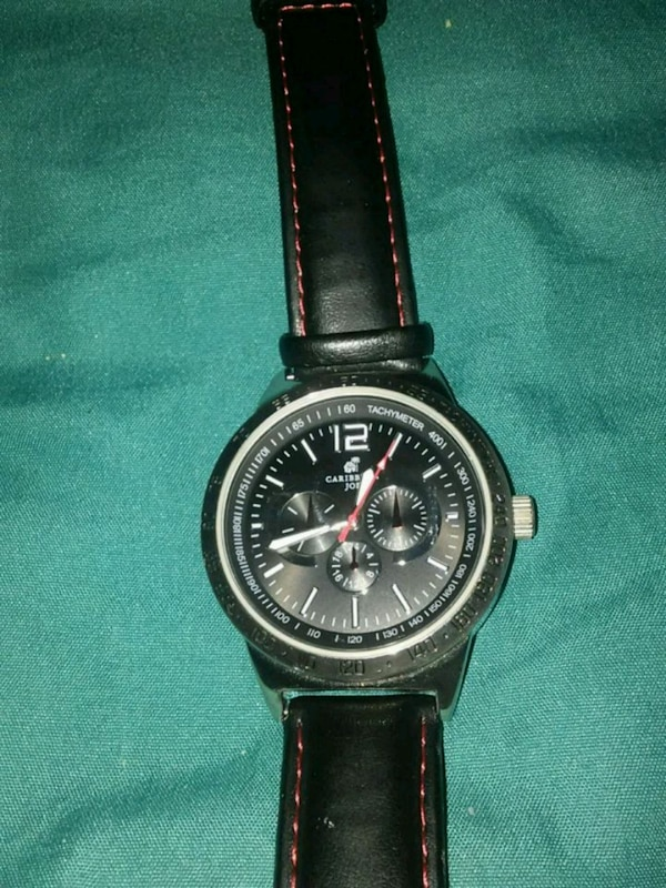 round black chronograph watch with black leather s