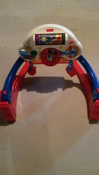 White, red and blue fisher-price activity toy