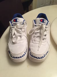 Next to brand new champion sneakers size 12 Calgary, T2Y 4R3