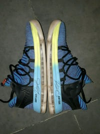 pair of blue-and-black Nike sneakers, month old ra