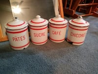 Four white-and-red ceramic jars 10 km