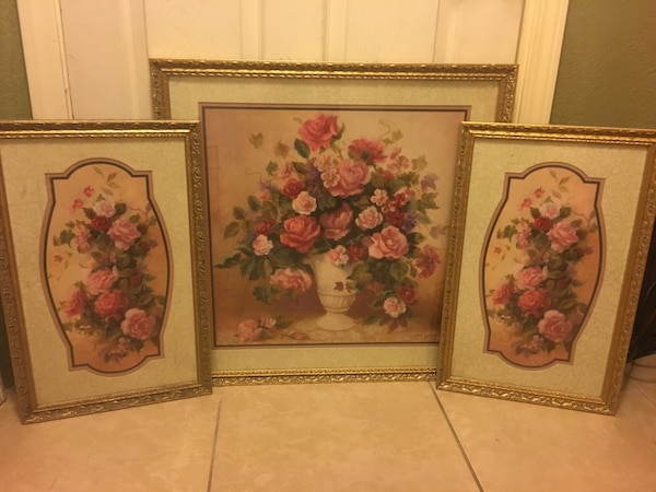 three brown wooden framed painting of flowers
