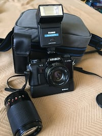 black Nikon DSLR camera with bag 33 km