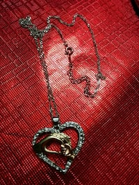 heart-shaped silver-colored pendant necklace