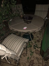 round gray metal patio table with chairs Dallas, 75206