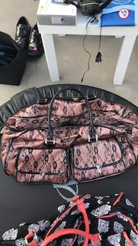 Two pink and black floral handbags Richmond Hill, 31324