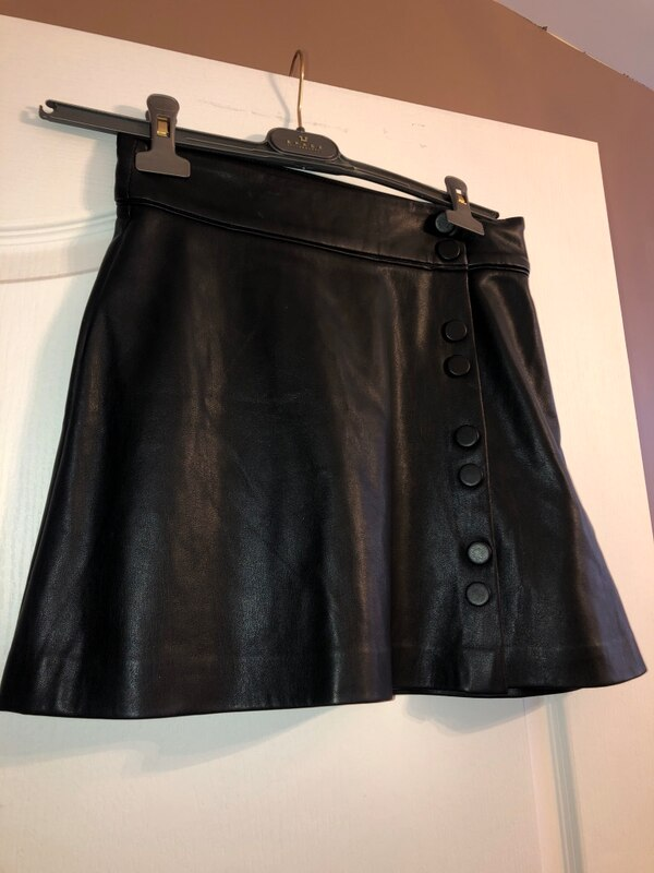 Woman's faux leather skirt with buttons 81a750d2-a01c-4bc4-9965-2e225e0074bd
