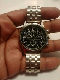 round silver chronograph watch with silver link br Toronto, M1K 1P8