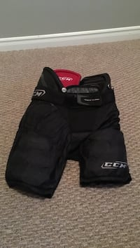 Black CCM hockey pants