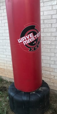red and black Wave Master free standing heavy bag Midland, 79703