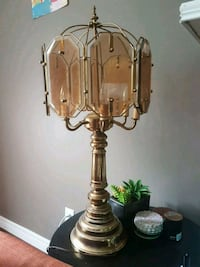 brass-colored table lamp London