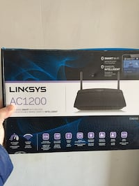 Black and gray linksys wireless router box Caledon