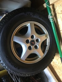 gray 5-spoke car wheel with tire St Catharines, L2P 1E7