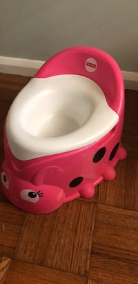 baby's pink and white plastic potty trainer Valparaiso, 46383