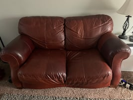 Leather couch, loveseat, chair, and ottoman