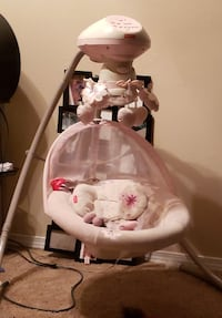 baby's white and pink cradle and swing