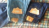 two pairs of blue and black Levi's jeans Boston, 02163