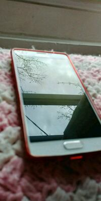 white Samsung Galaxy smartphone with red case Windsor, N8S 3B6