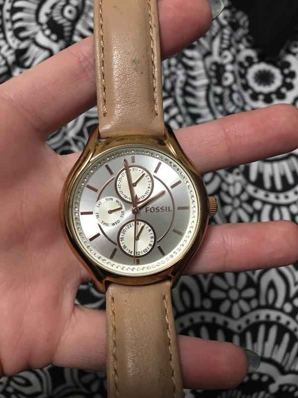 Stainless steel , genuine leather fossil watch