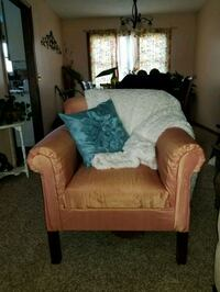 Orange covered accent chair