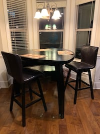 Triangular dining table with stools and bench